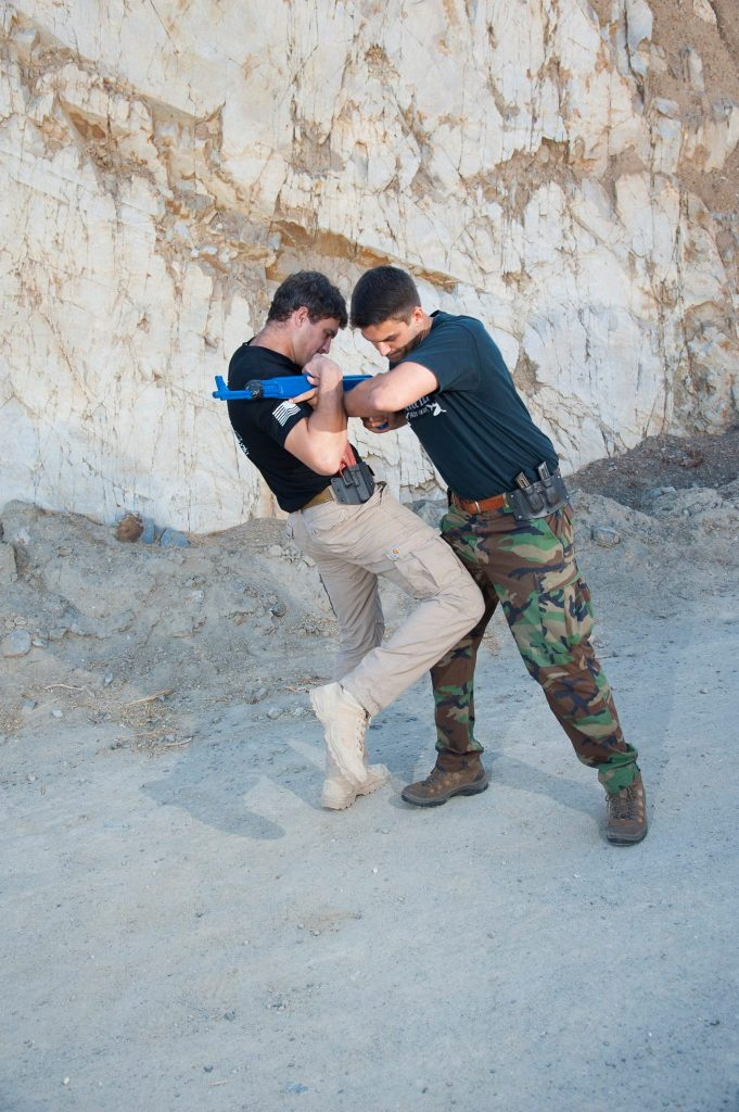 Krav Maga Instructor Alex Trafton showing how to disarm an active shooter
